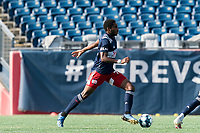 FOXBOROUGH, MA - JULY 25: USL League One (United Soccer League) match. Jon Bell #70 of New England Revolution II brings the ball forward during a game between Union Omaha and New England Revolution II at Gillette Stadium on July 25, 2020 in Foxborough, Massachusetts.