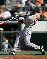 Baylor DH Dustin Dickerson swings against Texas on May 3rd, 2008. Photo by Andrew Woolley / Four Seam Images