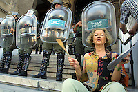 Delia Montes, 61,bang her pot outside the Supreme Court in Buenos Aires, January 10,2002. Under a very heavy security, handled by Argentinean army thousands of Argentineans demonstrate outside the Supreme Court demanding the Supreme Cort to quit blaming them from corruption, and asking the new President Duhalde to go. Photo by Quique Kierszenbaum
