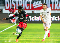 WASHINGTON, DC - MARCH 07: Oneil Fisher #91 of DC United clears from Lewis Morgan #7 of Inter Miami during a game between Inter Miami CF and D.C. United at Audi Field on March 07, 2020 in Washington, DC.