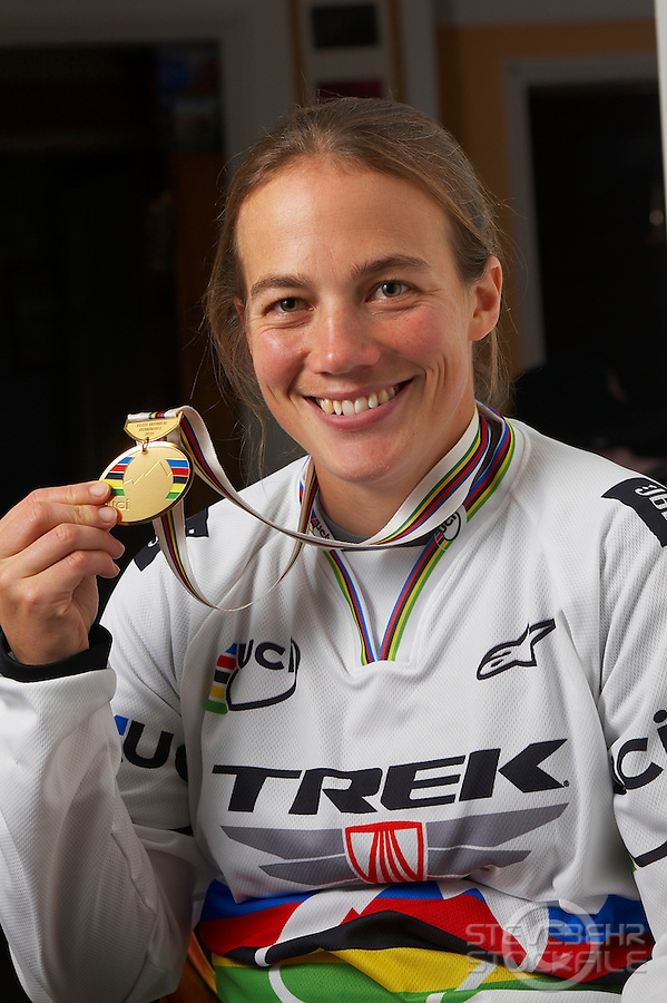 Tracy Moseley wearing wold champions jersey and gold medal ..Moseley family farm , Storridge , nr Malvern , Worcestershire..November 2010 pic copyright Steve Behr / stockfile