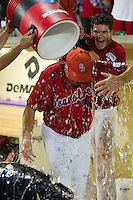 Stony Brook Seawolves catcher Pat Cantwell #3 dumps water on head coach Matt Senk after the NCAA Super Regional baseball game against LSU on June 10, 2012 at Alex Box Stadium in Baton Rouge, Louisiana. Stony Brook defeated LSU 7-2 to advance to the College World Series. (Andrew Woolley/Four Seam Images)