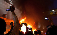 People record the chaos with cell phones, video and still cameras as rioters burn cars  in downtown Vancouver,BC after the Canucks were defeated by the Boston Bruins in the Stanly Cup on June 15, 2011. (photo copyright Karen Ducey)