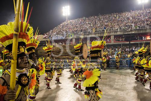 Imperatriz Leopolinense Samba School, Carnival, Rio de Janeiro, Brazil, 26th February 2017. Samba dancers dressed as Indians carrying felled tree trunks.