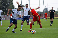 3rd September 2021; Newport, Wales:  Cian Ashfrod of Wales is challenged by Lee Jonas and Jadel Katongo of England during the U18 International Friendly  match between Wales and England at Newport Stadium in Newport, Wales.