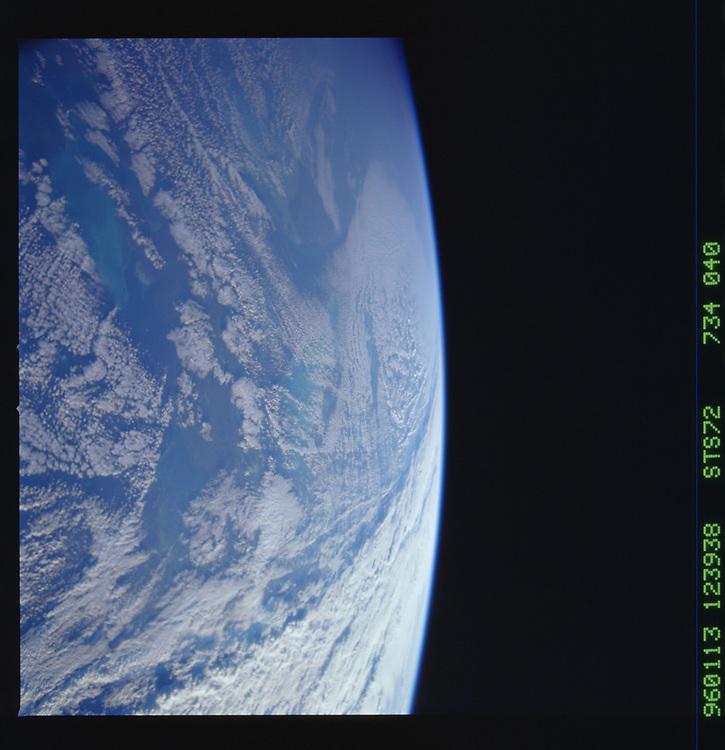 John Angerson. STS-72 Book.<br /> Public Domain Image.<br /> NASA images Courtesy National Archives - Record Group number: 255-STS-STS072<br /> Description: Earth observations taken from shuttle orbiter Endeavour during STS-72 mission.<br /> <br /> Subject Terms: STS-72, ENDEAVOUR (ORBITER), EARTH OBSERVATIONS (FROM SPACE), EARTH LIMB, WINDOWS<br /> <br /> Date Taken: 1/13/1996<br /> <br /> Categories: Earth Observations<br /> <br /> Interior_Exterior: Exterior<br /> <br /> Ground_Orbit: On-orbit<br /> <br /> Original: Film - 70MM CT<br /> <br /> Preservation File Format: TIFF<br /> <br /> geon: GULF OF MEXICO<br /> <br /> feat: PAN-LAND, CLOUDS<br /> <br /> tilt: High Oblique<br /> <br /> cldp: 75<br /> <br /> nlat: 18.8<br /> <br /> nlon: -82.2<br /> <br /> azi: 116<br /> <br /> alt: 252<br /> <br /> elev: 7