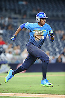 Hunter Greene (8) of the West Team runs to first base during a game the East Team during the Perfect Game All American Classic at Petco Park on August 14, 2016 in San Diego, California. West Team defeated the East Team, 13-0. (Larry Goren/Four Seam Images)