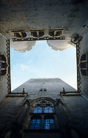 A view from a courtyard of the main tower looking up to two of the castle's six turrets