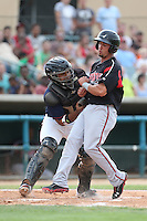 Jobduan Morales #7 of the Lancaster JetHawks tags out Benji Gonzalez #19 of the Lake Elsinore Storm at home plate during a game at The Hanger on August 2, 2014 in Lancaster, California. Lake Elsinore defeated Lancaster, 5-1. (Larry Goren/Four Seam Images)