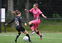 Taika De Koker (20) of Woluwe pictured in a duel with Alysson Duterne (14) of Sporting Charleroi during a female soccer game between Sporting Charleroi and White Star Woluwe on the first matchday in the 2021 - 2022 season of Belgian Scooore Womens Super League , friday 20 August 2021 in Marcinelle , Belgium . PHOTO SPORTPIX | DAVID CATRY