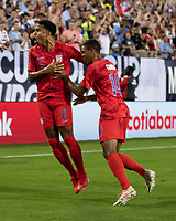 NASHVILLE, TN - JULY 3: Weston Mckennie #8 celebrates his goal with Reggie Cannon #14 during a game between Jamaica and USMNT at Nissan Stadium on July 3, 2019 in Nashville, Tennessee.