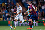 Carlos Henrique Casemiro (l) of Real Madrid is followed by SD Eibar players during the La Liga 2017-18 match between Real Madrid and SD Eibar at Estadio Santiago Bernabeu on 22 October 2017 in Madrid, Spain. Photo by Diego Gonzalez / Power Sport Images