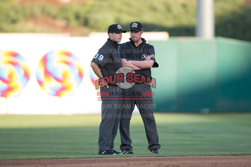 Field umpires Lewis Williams and Clay Park during a Pacific Coast League game between the Fresno Grizzlies and the Salt Lake Bees at Chukchansi Park on May 14, 2018 in Fresno, California. Fresno defeated Salt Lake 4-3. (Zachary Lucy/Four Seam Images)