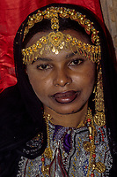 Oman.  Woman with Gold Jewelry Headdress and Necklace.