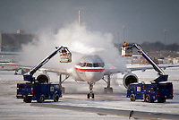 De-icing an airplane.