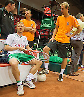 11-sept.-2013,Netherlands, Groningen,  Martini Plaza, Tennis, DavisCup Netherlands-Austria, Practice, Footbal Club FC Groningen is visiting the Dutch Daviscup team, Rasmus Lindgren (football) and Thiemo de Bakker<br /> Photo: Henk Koster