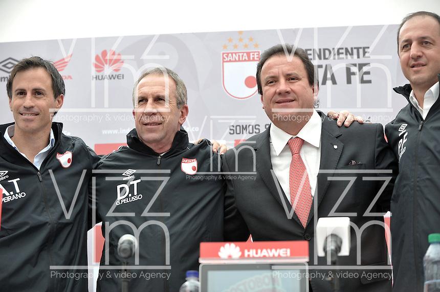 BOGOTA - COLOMBIA- 10-06-2015: Pablo Peirano (Izq.), Asistente Técnico, Gerardo Pelusso (2 Izq.), Tecnico,  Cesar Pastrana (2 Der.), Presidente de Independiente Santa  Fe y Javier Carvallo (Der.) Preparador Físico, durante presentación de Gerardo Pelusso, de Uruguay,  nuevo técnico de Independiente Santa Fe,  durante rueda de prensa en la sede del Club. Pelusso,  uruguayo de 60 años ha trabajado en clubes como la Universidsd de Chile, Olimpia   de Paraguay, Nacional  de Uruguay y la Selección  de Paraguay,  firmo contrato inicialmente por un año.  / Pablo Peirano (L), Assistant Coach, Gerardo Pelusso (2 L), Coach, Cesar Pastrana (2 R), President of Independiente Santa  Fe and Javier Carvallo (R) Physical Trainer, during a press conference in the clubhouse. Pelusso, Uruguayan, 60 years,  has worked in clubs like the Universidsd of Chile, Olimpia of Paraguay, Nacional of Uruguay and Paraguay Selection, signed contract initially for a year. Photo: VizzorImage / Luis Ramirez / Staff