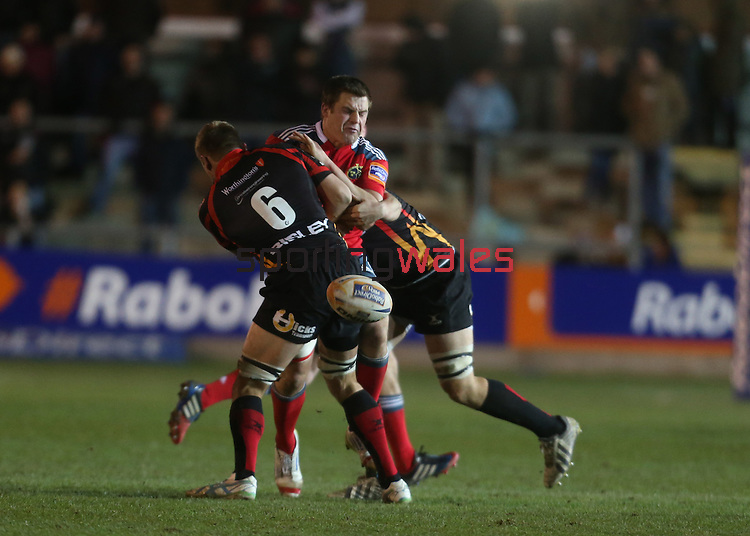 Munster flanker CJ Stander spills the ball in the tackle.<br /> RaboDirect Pro12<br /> Newport Gwent Dragons v Munster<br /> Rodney Parade - Newport<br /> 29.11.13<br /> ©Steve Pope-SPORTINGWALES