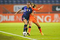 BREDA, NETHERLANDS - NOVEMBER 27: Margaret Purce #30 of the United States battles with Lieke Martens #11 of the Netherlands during a game between Netherlands and USWNT at Rat Verlegh Stadion on November 27, 2020 in Breda, Netherlands.