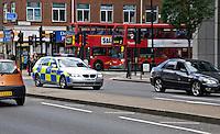 Silver 5 series BMW Metropoitan Police car on emergency call London UK.