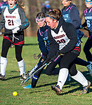 LITCHFIELD, CT-111820JS11—Wamogo's Kaleigh Langlais (30) pushes the ball past Shepaug's Brooke Mercier   (3) during their field hockey game Wednesday at Wamogo High School. <br />  Jim Shannon Republican-American