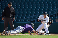 Bobby Seymour (3) of the Wake Forest Demon Deacons waits for a pick-off throw as Logan Taplett (7) of the Furman Paladins dives back towards first base at BB&T BallPark on March 2, 2019 in Charlotte, North Carolina. The Demon Deacons defeated the Paladins 13-7. (Brian Westerholt/Four Seam Images)