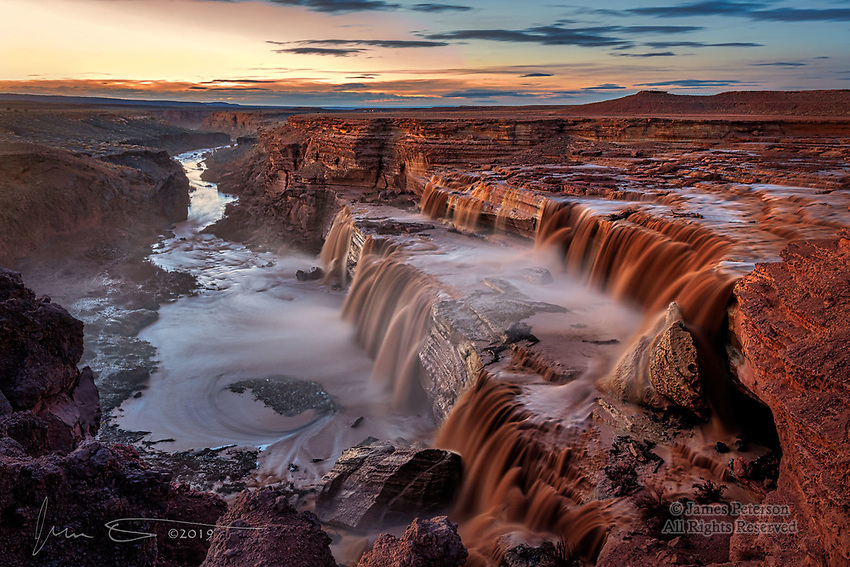 Grand Falls at Dusk ©2019 James D. Peterson.  With the LIttle Colorado River quite swollen after a very wet winter storm, Northern Arizona's Grand Falls (also known as Chocolate Falls) had more water flowing than I had ever seen before.  This is a 15 second exposure made around 25 minutes after sundown, with the scene bathed in the fading warm glow of sunset.