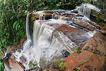 Giluk Falls tumble off the southern plateau, with lowland Dipterocarp rainforest below. Centre of Maliau Basin - Sabah's 'Lost World' - Borneo.