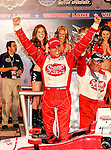 Justin Wilson (18) driver of the Sonny's BBQ car celebrates in the winners circle after the IZOD Indycar Firestone 550 race at Texas Motor Speedway in Fort Worth,Texas. Justin Wilson (18) wins the Firestone 550 race...