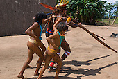 Xingu Indigenous Park, Mato Grosso State, Brazil. Aldeia Kamaiura. Taquara (flute bamboo)  festival; girls join the men in the dance.