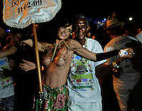 Movie maker and topless dancer Ana Paula Gonvßalves Nogueira, left, and samba dancer Peninha, right, perform during a street parade of  Banda da Rua do Mercado, Rio de Janeiro, Brazil, February 27, 2014.<br /> People gathered Thursday for one of many parades before the official start of Carnival on Feb. 28. (Austral Foto/Renzo Gostoli)