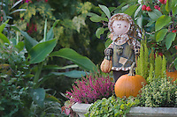 Garden Decoration, girl, pumpkin, fall, Oberaegeri, Switzerland, August 2006