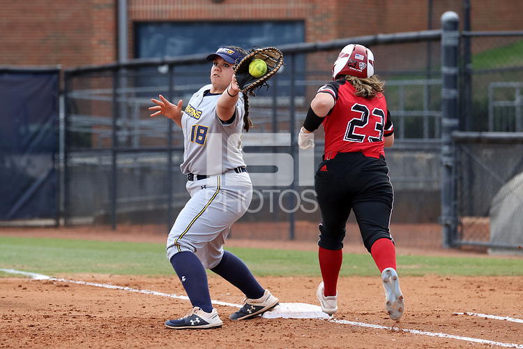 GREENSBORO, NC - MARCH 11: Samantha Lagrama #18 of UNC Greensboro forces Anne Allen #23 of Northern Illinois University out at first base during a game between Northern Illinois and UNC Greensboro at UNCG Softball Stadium on March 11, 2020 in Greensboro, North Carolina.