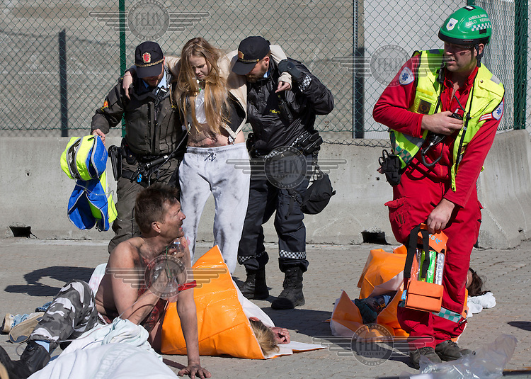 """Police and paramedic help """"victims"""". HarbourEx15, a field training exercise with scenarios connected to operations in the harbor April 27th – 29th 2015.<br /> <br /> The scenario of the exercise is a major accident on Sydhavna /Sjursjøya area of Oslo, and will involve rescue and emergency response agencies from tactical to strategic level. (photo: Fredrik Naumann/Felix Features)"""