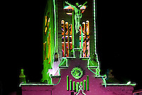 A sculpture of Jesus Christ is seen on a greenly illuminated church bell tower during the annual Festival of Candles and Lanterns in Quimbaya, Colombia, 8 December 2013. A vibrant event, celebrated since 1982 and attracting tens of thousands of visitors every year, is held in honor of the Virgin Mary, on the day of the Catholic Feast of the Immaculate Conception. Each street and neighborhood in the town compete in the contest to create the most spectacular lighting arrangement of their place, employing creatively elaborated lantern designs, which range from religious themes, to symbols of the coffee region or the environmental and wild nature motives. All the streets in Quimbaya center close for one night and some 40,000 lanterns are being lightened up at the festive night.