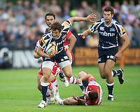20120803 Copyright onEdition 2012©.Free for editorial use image, please credit: onEdition..Tom Brady of Sale Sharks runs through the tackle of Dave Lewis of Gloucester Rugby at The Recreation Ground, Bath in the Final round of The J.P. Morgan Asset Management Premiership Rugby 7s Series...The J.P. Morgan Asset Management Premiership Rugby 7s Series kicked off again for the third season on Friday 13th July at The Stoop, Twickenham with Pool B being played at Edgeley Park, Stockport on Friday, 20th July, Pool C at Kingsholm Gloucester on Thursday, 26th July and the Final being played at The Recreation Ground, Bath on Friday 3rd August. The innovative tournament, which involves all 12 Premiership Rugby clubs, offers a fantastic platform for some of the country's finest young athletes to be exposed to the excitement, pressures and skills required to compete at an elite level...The 12 Premiership Rugby clubs are divided into three groups for the tournament, with the winner and runner up of each regional event going through to the Final. There are six games each evening, with each match consisting of two 7 minute halves with a 2 minute break at half time...For additional images please go to: http://www.w-w-i.com/jp_morgan_premiership_sevens/..For press contacts contact: Beth Begg at brandRapport on D: +44 (0)20 7932 5813 M: +44 (0)7900 88231 E: BBegg@brand-rapport.com..If you require a higher resolution image or you have any other onEdition photographic enquiries, please contact onEdition on 0845 900 2 900 or email info@onEdition.com.This image is copyright the onEdition 2012©..This image has been supplied by onEdition and must be credited onEdition. The author is asserting his full Moral rights in relation to the publication of this image. Rights for onward transmission of any image or file is not granted or implied. Changing or deleting Copyright information is illegal as specified in the Copyright, Design and Patents Act 1988. If you are in any way unsure of your right