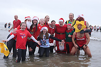 Pictured: People in fancy dress take to the sea in Cefn Sidan, Wales, UK. Thursday 26 December 2019<br /> Re: Hundreds of people have taken part in this year's Walrus Dip, a fancy dress Boxing Day swim in Cefn Sidan beach near Pembrey, Wales, UK.
