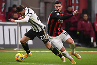 Federico Chiesa of Juventus FC and Theo Hernandez of AC Milan during the Serie A football match between AC Milan and Juventus FC at San Siro Stadium in Milano  (Italy), January 6th, 2021. Photo Federico Tardito / Insidefoto