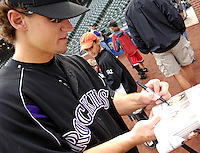 10 September 2006: Jeff Salazar, outfielder for the Colorado Rockies, signs autographs prior to a game against the Washington Nationals. The Rockies defeated the Nationals 13-9 at Coors Field in Denver, Colorado...Mandatory Photo Credit: Ed Wolfstein.