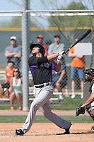Kent Matthes #20 of the Colorado Rockies bats during a Minor League Spring Training Game against the San Francisco Giants at the Colorado Rockies Spring Training Complex on March 18, 2014 in Scottsdale, Arizona. (Larry Goren/Four Seam Images)