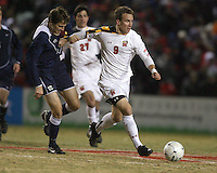 Jason Herrick #9 of the University of Maryland pushes away from Andy Parr #12 of Penn State during an NCAA 3rd. round match at Ludwig Field, University of Maryland, College Park, Maryland on November 28 2010.Maryland won 1-0.