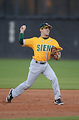 Siena Saints infielder Yahirel Jimenez (7) during warmups before the season opening game against the Central Florida Knights at Jay Bergman Field on February 14, 2014 in Orlando, Florida.  UCF defeated Siena 8-1.  (Copyright Mike Janes Photography)