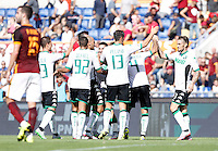 Calcio, Serie A: Roma vs Sassuolo. Roma, stadio Olimpico, 20 settembre 2015.<br /> Sassuolo's Matteo Politano, center, celebrates with teammates after scoring during the Italian Serie A football match between Roma and Sassuolo at Rome's Olympic stadium, 20 September 2015.<br /> UPDATE IMAGES PRESS/Isabella Bonotto