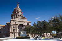 Texas civil war battle cannons grace the Texas State Capitol grounds under snow in January snow.