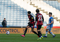 13th April 2021; The John Smiths Stadium, Huddersfield, Yorkshire, England; English Football League Championship Football, Huddersfield Town versus Bournemouth; Philip Billing of Bournemouth plays a pass across teammate Ben Pearson of Bournemouth as Jonathan Hogg of Huddersfield Town closes in