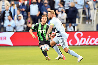 KANSAS CITY, KS - MAY 9: Johnny Russell #7 Sporting KC with the ball during a game between Austin FC and Sporting Kansas City at Children's Mercy Park on May 9, 2021 in Kansas City, Kansas.