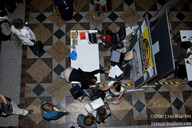 Last minute Fossil of the day preparations. United Nations Climate Talks in Bonn Germany (©Robert vanWaarden)