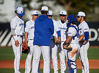IMG Academy Ascenders pitching coach Ted Power talks with pitcher Ben Waxler (27) during a game against the Victory Charter School Knights on February 28, 2020 at IMG Academy in Bradenton, Florida.  (Mike Janes/Four Seam Images)