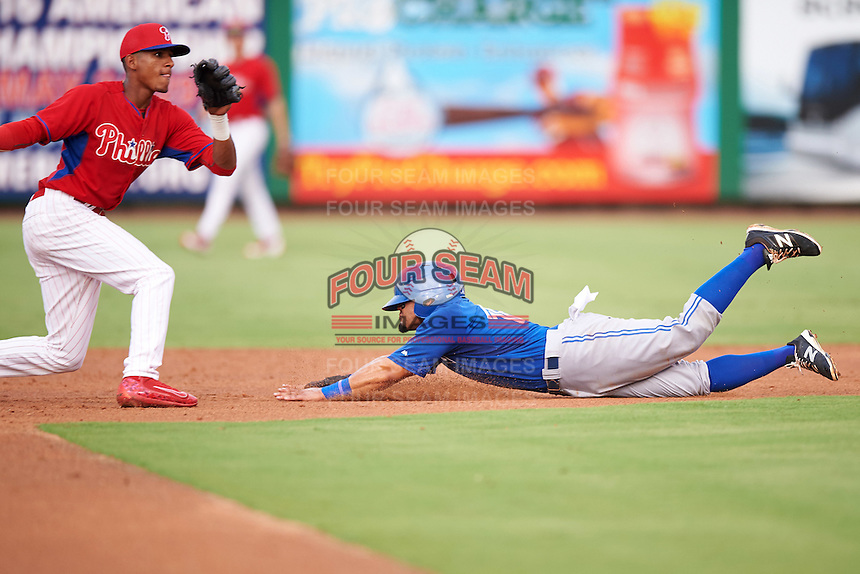 GCL Blue Jays Alfredo Bohorquez (13) slides safely into second base as shortstop Jose Antequera (left) awaits the throw during a game against the GCL Phillies on August 16, 2016 at Bright House Field in Clearwater, Florida.  GCL Blue Jays defeated GCL Phillies 2-1.  (Mike Janes/Four Seam Images)