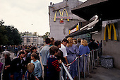"""Moscow, Russia<br /> Soviet Union<br /> August 30, 1991<br /> <br /> People line up to enter one of the first McDonalds, an American fast food chain restaurant, in Russia at Groky Street.<br /> <br /> In December 1991, food shortages in central Russia had prompted food rationing in the Moscow area for the first time since World War II. Amid steady collapse, Soviet President Gorbachev and his government continued to oppose rapid market reforms like Yavlinsky's """"500 Days"""" program. To break Gorbachev's opposition, Yeltsin decided to disband the USSR in accordance with the Treaty of the Union of 1922 and thereby remove Gorbachev and the Soviet government from power. The step was also enthusiastically supported by the governments of Ukraine and Belarus, which were parties of the Treaty of 1922 along with Russia.<br /> <br /> On December 21, 1991, representatives of all member republics except Georgia signed the Alma-Ata Protocol, in which they confirmed the dissolution of the Union. That same day, all former-Soviet republics agreed to join the CIS, with the exception of the three Baltic States."""